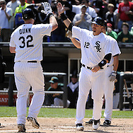 CHICAGO - JUNE 12:  Adam Dunn #32 is greeted by A.J. Pierzynski #12 of the Chicago White Sox after Dunn hit a three-run home run off of Guillermo Moscoso #52 of the Oakland Athletics in the fourth inning on June 12, 2011 at U.S. Cellular Field in Chicago, Illinois.  The White Sox defeated the Athletics 5-4.  (Photo by Ron Vesely)   Subject:  Guillermo Moscoso;Adam Dunn;A.J. Pierzynski
