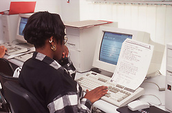 Woman working at desk in office using computer,