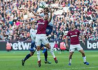 Football - 2018 / 2019 Premier League - West Ham United vs. Tottenham Hotspur<br /> <br /> Harry Kane (Tottenham FC)  and Fabian Balbuena (West Ham United) tangle for the ball at the London Stadium<br /> <br /> COLORSPORT/DANIEL BEARHAM