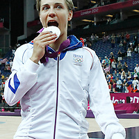 11 August 2012: France Celine Dumerc poses with her silver medal during 86-50 Team USA victory over Team France, during the Women's Gold Medal Game, at the North Greenwich Arena, in London, Great Britain.