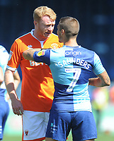 Blackpool's Chris Taylor remonstrates with Wycombe Wanderers' Sam Saunders<br /> <br /> Photographer Kevin Barnes/CameraSport<br /> <br /> The EFL Sky Bet League One - Wycombe Wanderers v Blackpool - Saturday 4th August 2018 - Adams Park - Wycombe<br /> <br /> World Copyright © 2018 CameraSport. All rights reserved. 43 Linden Ave. Countesthorpe. Leicester. England. LE8 5PG - Tel: +44 (0) 116 277 4147 - admin@camerasport.com - www.camerasport.com