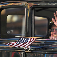 Dwaine Jones, a World War II Navy veteran, waves to the crowd as he is driven down Wall Street during the Veterans Day Parade in downtown Bend on Saturday.<br /> <br /> (PLEASE USE AS MAIN PHOTO)<br /> <br /> (Ryan Brennecke/Bulletin photo)
