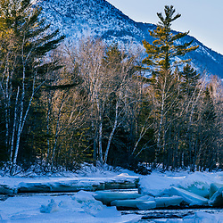 Ice on the East Branch of the Penobscot River in Maine's Katahdin Woods and Waters National Monument. Billfish Mountain is in the distance.