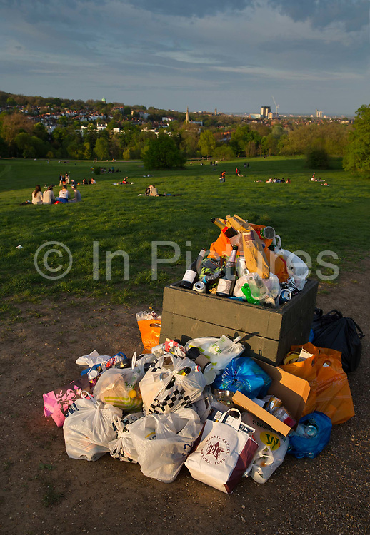 Overflowing rubbish bin at the end of a summer afternoon on 7th May 2016 in Hampstead Heath, London, United Kingdom. Currently, London has only one active landfill on its territory, the Veolia waste in Rainham and has been there for over 150 years.