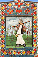 Tombstone of a farmer on the way to cut hay, The  Merry Cemetery ( Cimitirul Vesel ),  Săpânţa, Maramares, Northern Transylvania, Romania.  The naive folk art style of the tombstones created by woodcarver  Stan Ioan Pătraş (1909 - 1977) who created in his lifetime over 700 colourfully painted wooden tombstones with small relief portrait carvings of the deceased or with scenes depicting them at work or play or surprisingly showing the violent accident that killed them. Each tombstone has an inscription about the person, sometimes a light hearted  limerick in Romanian. .<br /> <br /> Visit our ROMANIA HISTORIC PLACXES PHOTO COLLECTIONS for more photos to download or buy as wall art prints https://funkystock.photoshelter.com/gallery-collection/Pictures-Images-of-Romania-Photos-of-Romanian-Historic-Landmark-Sites/C00001TITiQwAdS8