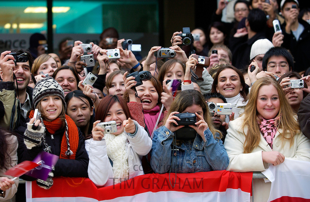 A happy crowd of Essex  University Students taking photographs