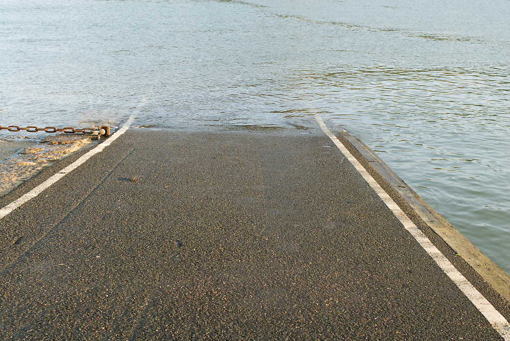 A road disappears under water at a ferry slipway in Dartmouth,Devon. England 2007.