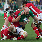 """Paul O""""Connell, Ireland, is tackled during the Ireland V Wales Quarter Final match at the IRB Rugby World Cup tournament. Wellington Regional Stadium, Wellington, New Zealand, 8th October 2011. Photo Tim Clayton..."""