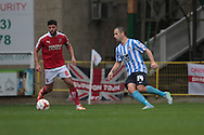 Coventry City midfielder Joe Cole and Swindon Town midfielder Yaser Kasim during the Sky Bet League 1 match between Swindon Town and Coventry City at the County Ground, Swindon, England on 24 October 2015. Photo by Jemma Phillips.