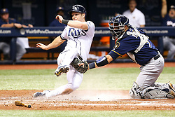 August 4, 2017 - St. Petersburg, Florida, U.S. - WILL VRAGOVIC   |   Times.Tampa Bay Rays left fielder Corey Dickerson (10) tagged by Milwaukee Brewers catcher Manny Pina (9) attempting to score on the double by Tampa Bay Rays third baseman Evan Longoria (3) to end the seventh inning of the game between the Milwaukee Brewers and the Tampa Bay Rays at Tropicana Field in St. Petersburg, Fla. on Friday, August 4, 2017. (Credit Image: © Will Vragovic/Tampa Bay Times via ZUMA Wire)