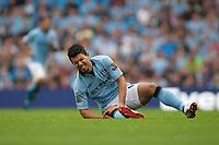 Football - Premier League - Manchester City vs. Southampton<br /> Sergio Aguero of Manchester City lies injured at Etihad Stadium