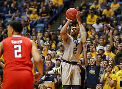 Feb 26, 2018; Morgantown, WV, USA; West Virginia Mountaineers guard Jevon Carter (2) shoots a three pointer during the second half against the Texas Tech Red Raiders at WVU Coliseum. Mandatory Credit: Ben Queen-USA TODAY Sports