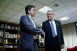 June 28, 2017 - Athens, Greece - Greek Finance Minister Euclid Tsakalotos meets with Klaus Regling (R) Managing Director of the European Stability Mechanism and CEO of the European Financial Stability Facility (EFSF) at Finance Ministry, in Athens on June 28, 2017, a few hours before tomorrow's EuroWorking Group meeting that will re-examine the list of 140 prerequisites, in order to give the green light to ESM to authorize the disbursement of the 7.7 billion euro tranche to Greece. Regling visits Greece to participate at an Economist conference in Lagonissi, Athens. (Credit Image: © Panayotis Tzamaros/NurPhoto via ZUMA Press)