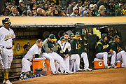 The Oakland Athletics react to a loss against the Miami Marlins at Oakland Coliseum in Oakland, Calif., on May 23, 2017. (Stan Olszewski/Special to S.F. Examiner)