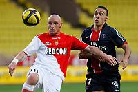 FOOTBALL - FRENCH CHAMPIONSHIP 2010/2011 - L1 - AS MONACO v PARIS SAINT GERMAIN - 7/05/2011 - PHOTO PHILIPPE LAURENSON / DPPI - SEBASTIEN PUYGRENIER (ASM) / MEVLUT ERDING (PSG)
