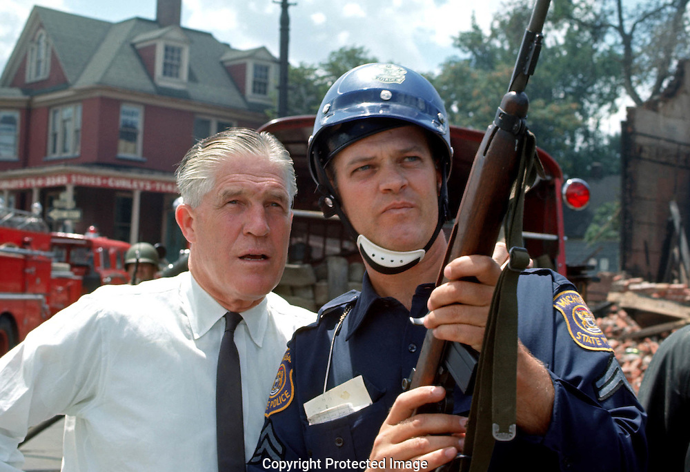 A 28MG FILE FROM FILM OF;.Governor George Romney talking to a Michigan State Trooper furing the Detroit Riots. Photo by Dennis Brack