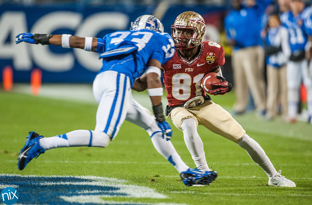 Florida State's Kenny Shaw looks for room to get around against Duke's Deondre Singleton during the ACC Championship game at Bank of America Stadium in Charlotte Saturday night. Florida State won the game 45-7.