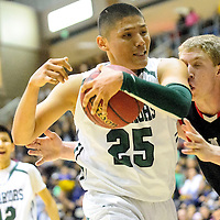 021214  Adron Gardner/Independent<br /> <br /> Tuba City Warrior Tyler Johnson (25), left, bumps Page Sand Devil Roger Sandall (34)  on the nose after recovering a rebound in Chinle Wednesday.