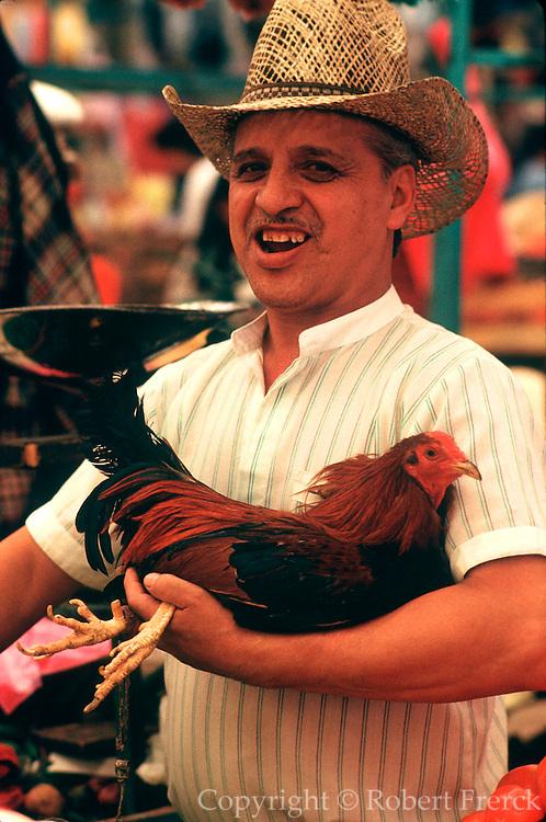 MEXICO, MARKETS Xochimilco; man with chicken