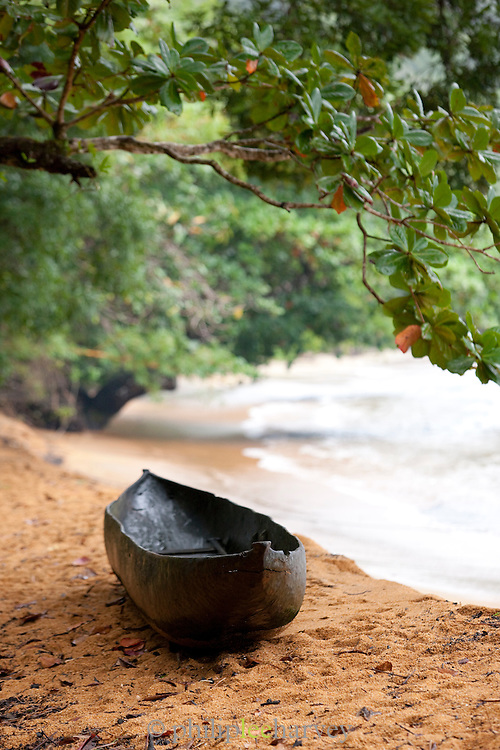 A wooden dugout canoe on the beach of the island reserve Nosy Mangabe, Madagascar