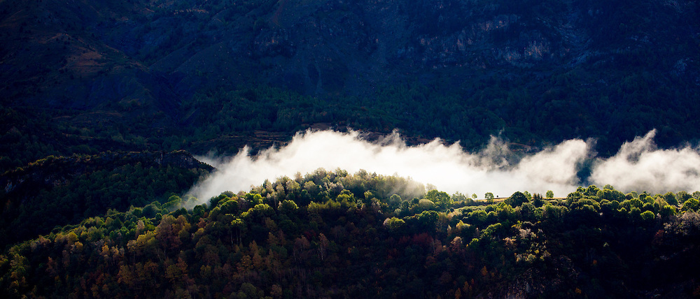 Clouds drifting through mountain valley landscape of Valle de Tena in the Pyrenees in Aragon, Northern Spain RESERVED USE