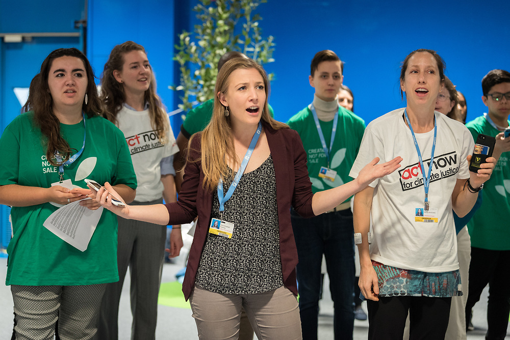 6 December 2019, Madrid, Spain: Faith-based actors led by ACT Alliance, the Lutheran World Federation, and the World Council of Churches 'sound the alarm for climate justice' at COP25, through a protest where a giant alarm clock went off, followed by testimonies of people already affected by climate change, and the chant, 'What do we want? Climate justice! When do we want it? Now! Where do we want it? Everywhere!' Here, Lutheran World Federation delegate Erika Rodning from the Evangelical Lutheran Church in Canada.