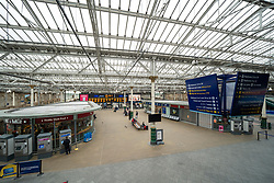 Edinburgh, Scotland, UK. 24 March, 2020.  Interior view of almost deserted concourse at Waverley Station during the normal morning rush hour. All shops and restaurants are closed with very few people venturing outside following the Government imposed lockdown today. Iain Masterton/Alamy Live News