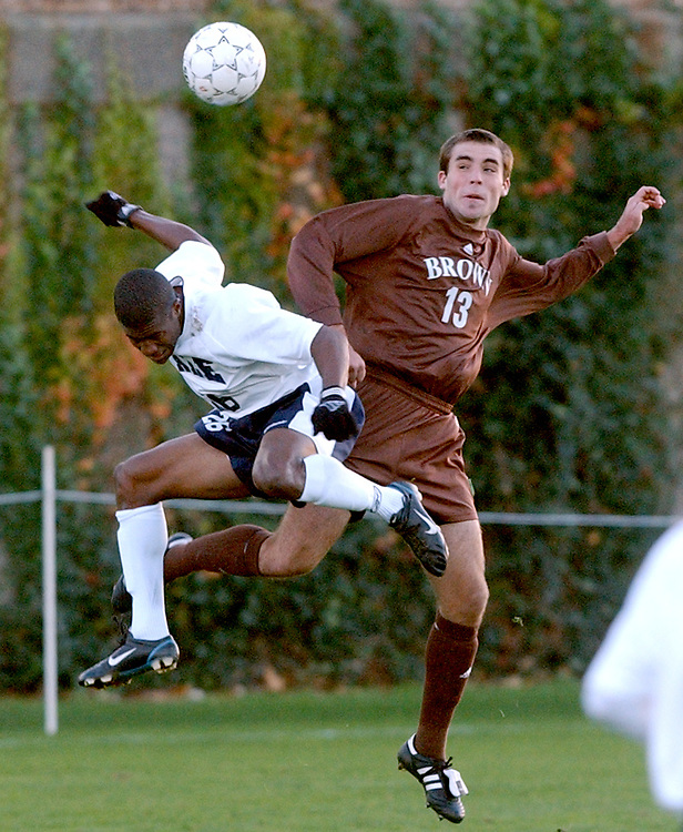 Spt11/08/03  Photo by Mara Lavitt--Y-B soccer 1<br />ML0097b #8713<br />Yale Soccer stadium, first half action:  Yale's Lindsey Williams left and Brown's Matt Britner right up for the header.