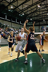 10 January 2009: Colleen Caplice looks for the bucket over Annie Bowen. The Lady Titans of Illinois Wesleyan University downed the and Lady Thunder of Wheaton College by a score of 101 - 57 in the Shirk Center on the Illinois Wesleyan Campus in Bloomington Illinois.