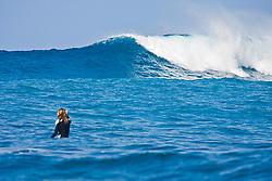 Woman surfer, waiting for a rare big ocean wave in Kona Coast, Keauhou Bay, Big Island, Hawaii, Pacific Ocean
