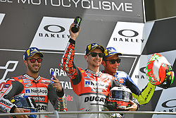 June 3, 2018 - Mugello, Italy, Italy - 99 JORGE LORENZO from Spain, winner (Ducati Team), #04 ANDREA DOVIZIOSO from Italy, second classified (Ducati Team), and #46 VALENTINO ROSSI from Italy third classified (Movistar Yamaha), Gran Premio d'Italia Oakley, during the podium celebration at the Mugello International Circuit for the 6th round of MotoGP World Championship, from June 1st to 3rd  (Credit Image: © Felice Monteleone/NurPhoto via ZUMA Press)
