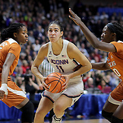 UNCASVILLE, CONNECTICUT- DECEMBER 4:  Kia Nurse #11 of the Connecticut Huskies drives to the basket defended by Jordan Hosey #5 of the Texas Longhorns and Lashann Higgs #10 of the Texas Longhorns during the UConn Huskies Vs Texas Longhorns, NCAA Women's Basketball game in the Jimmy V Classic on December 4th, 2016 at the Mohegan Sun Arena, Uncasville, Connecticut. (Photo by Tim Clayton/Corbis via Getty Images)