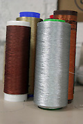 Metal industrial weaving threads to reinforce the fabric
