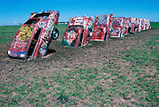 Cadillac Ranch near Ararillo, Texas was an art installation by the group Ant Farm.  10 classic cadillacs buried into was an art project sponsored by the eccentric Texas millionaire Stanley Marsh.