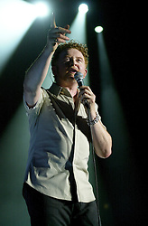 """Mick Hucknall/Simply Red live at Sheffields Hallam FM Arena during their 2003 """"Home"""" Tour<br /> Michael James """"Mick"""" Hucknall (born 8 June 1960) is an English pop singer and songwriter. Formerly the lead singer of the modestly successful punk rock band the Frantic Elevators, Hucknall achieved international fame in the 1980s as the lead singer and songwriter of the soul-influenced pop band Simply Red. They sold more than 50 million albums over a 25-year career. Their style drew upon influences ranging from blue-eyed soul, New Romantic and rock to reggae and jazz<br /> <br /> Copyright Paul David Drabble<br /> 03 May 2003"""