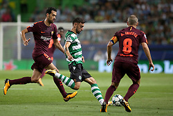 September 27, 2017 - Lisbon, Portugal - Sporting's midfielder Bruno Fernandes from Portugal (C ) vies with Barcelona's Spanish midfielder Sergio Busquets (L) and Barcelona's Spanish midfielder Andres Iniesta (R ) during the UEFA Champions League football match Sporting vs Barcelona at the Alvalade stadium in Lisbon, Portugal on September 27, 2017. Photo: Pedro Fiuza  (Credit Image: © Pedro Fiuza/NurPhoto via ZUMA Press)