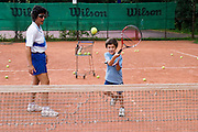 Moscow, Russia, 04/08/2004..Spartak Tennis Club is Russia's leading tennis school, discovering and coaching the new generation of Russian tennis stars. A five year old boy learning his first tennis moves.