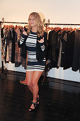 CHLOE MADELEY dancing at a party to celebrate the opening of the new Mina Store at 36-38 Great Titchfield Street, London W1W 8BQ on 9th September 2010.  The party was sponsored by Ivan the Terrible Vodka.