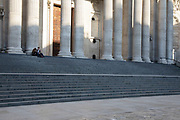 Lone figures on the steps of St Pauls Cathedral under Coronavirus on 23rd March 2020 in London, England, United Kingdom. Following government advice most people are staying at home leaving the streets quiet, empty and eerie. Coronavirus or Covid-19 is a new respiratory illness that has not previously been seen in humans. While much or Europe has been placed into lockdown, the UK government has announced more stringent rules as part of their long term strategy, and in particular social distancing.