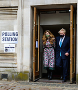 London, Britain, May, 6, 2021 — Prime Minister Boris Johnson and his fiancee Carrie Symonds leave the polling station on Thursday morning, after casting their vote at Methodist Central Hall, central London, in the local and London Mayoral election. (Photo/ Vudi Xhymshiti)