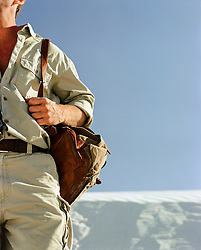 detail of a hiker in White Sands National Park in New Mexico
