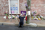ANDREW SHURTLEFF/DAILY PROGRESS PHOTO<br /> A demonstrator takes a moment to reflect at the Heather Heyer memorial Sunday on the anniversary of August 12th.