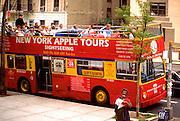 Tourist double decker bus downtown.  New York New York USA