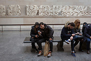 Visitors ignore the antiquities of the Elgin Marbles in the British Museum that originate from the Parthenon in Athens, on 28th February 2017, in London, England.
