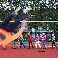 Nederland, Zaandam , 8 september 2014.<br /> Een groep Nordic Walkers  Traint voor de Dam tot Damloop  op een atletiekbaan in Zaandam.<br /> Foto:Jean-Pierre Jans