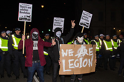 London, November 5th 2016. Anti-capitalists and anarchists participate in the Million Mask March, an annual event that happens on November 5th each year in cities across the world, as part of a protest against the establishment. Many of the protesters wear Guy Fawkes masks, often associated with the internet activism group Anonymous. PICTURED: Protesters pose for pictures in front of a line of riot police.