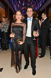 LOUISE THOMPSON and ALIK ALFUS at Steps To The Future -in aid of RAFT (Restoration of Appearance & Function Trust) and Walking With The Wounded held at The Hurlingham Club, London on 28th November 2014.