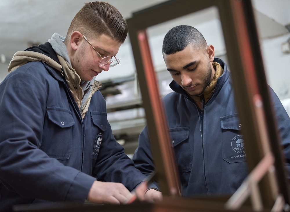 25 February 2020, Jerusalem: Students Sami (left) and Mohammad (right) work on constructing a window frame, during class in Aluminium work at the vocational training centre in Beit Hanina. The Lutheran World Federation's vocational training centre in Beit Hanina offers vocational training for Palestinian youth across a range of different professions, providing them with the tools needed to improve their chances of finding work.