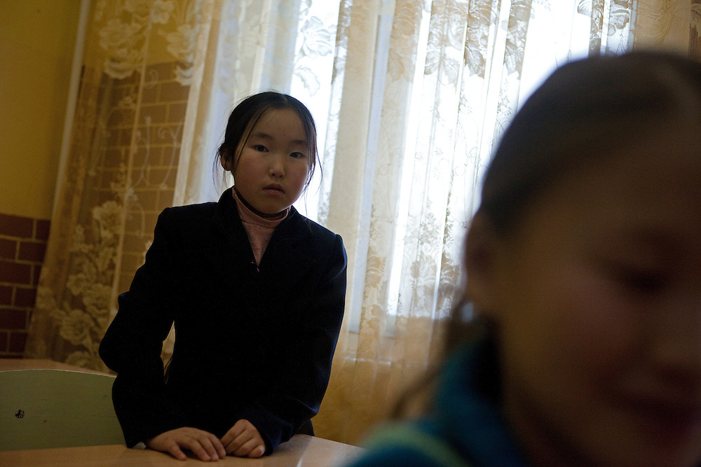 Yakutian school girl during a class at the school in Oymyakon. The area is extremely cold during the winter. Two towns by the highway, Tomtor and Oymyakon, both claim the coldest inhabited place on earth (often referred to as -71.2°C, but might be -67.7°C) outside of Antarctica. The average temperature in Oymyakon in January is -42°C (daily maximum) and -50°C (daily minimum). The images had been made during an outside temperature in between -50°C up to -55°C. Oymyakon, Oimjakon, Yakutia, Jakutien, Russian Federation, Russia, RUS, 20.01.2010