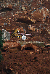 (170818) -- FREETOWN, Aug. 18, 2017 (Xinhua) -- A rescuer works on the site of the mudslides in Freetown, capital of Sierra Leone, on Aug. 18, 2017. The UN Office for the Coordination of Humanitarian Affairs (OCHA) on Friday said that more than 400 people had lost their lives in the mudslides that had occurred on Aug. 14 and that several hundred people were still missing, meaning that the death toll could still increase. (Xinhua/Chen Cheng) (Photo by Xinhua/Sipa USA)
